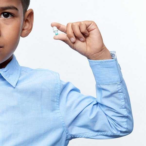 Child holding up Kids Earplugs