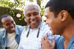 Men enjoying conversation with hearing aid