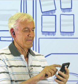 Man sing BeHear NOW with smartphone